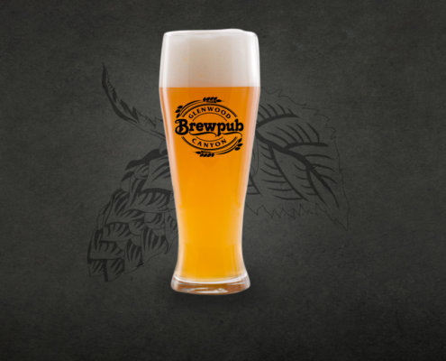 Zephyr Hefeweizen in a Glenwood Canyon Brewpub glass in front of dark background and hops logo
